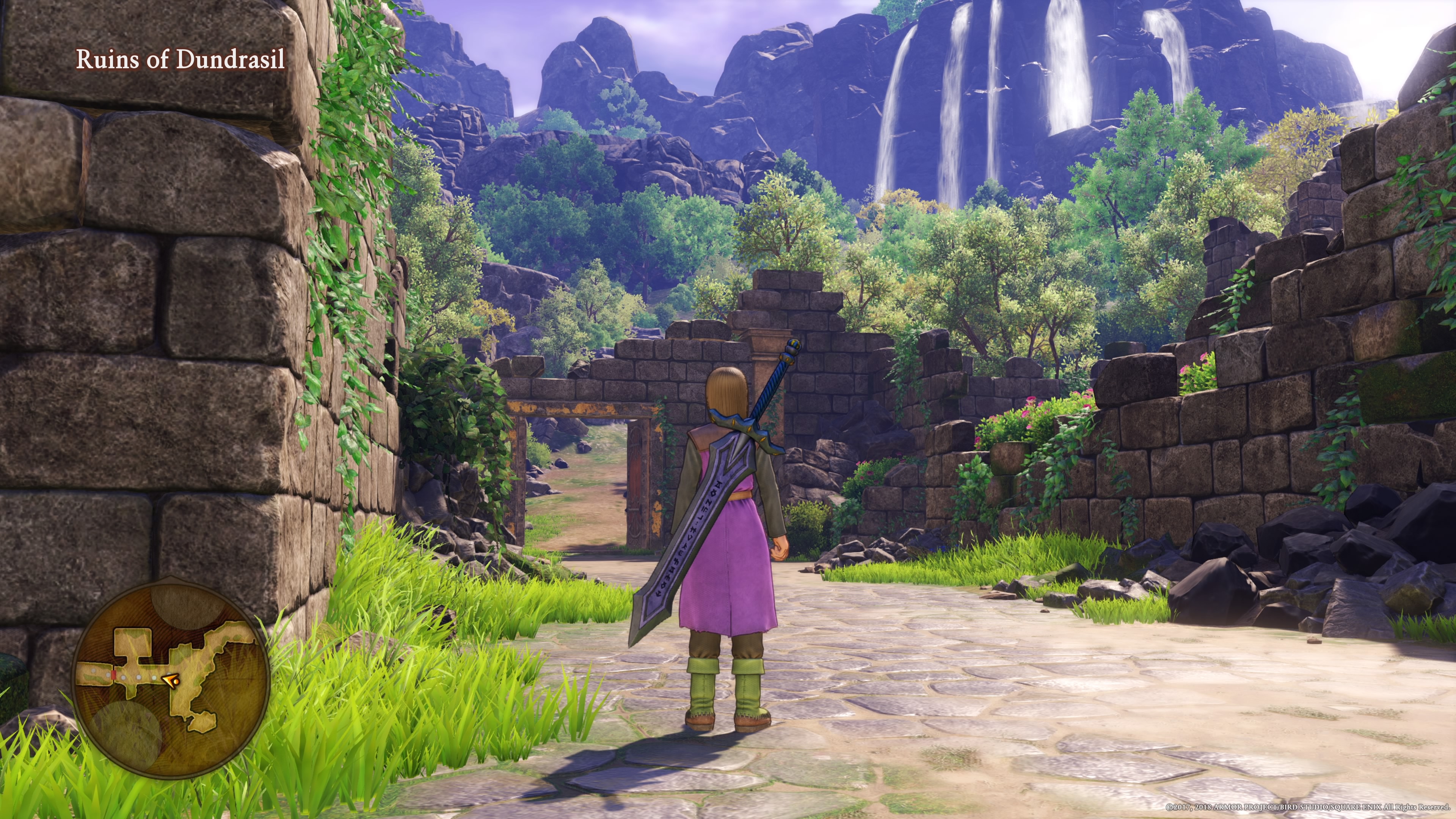 The protagonist stands before a ruined castle.